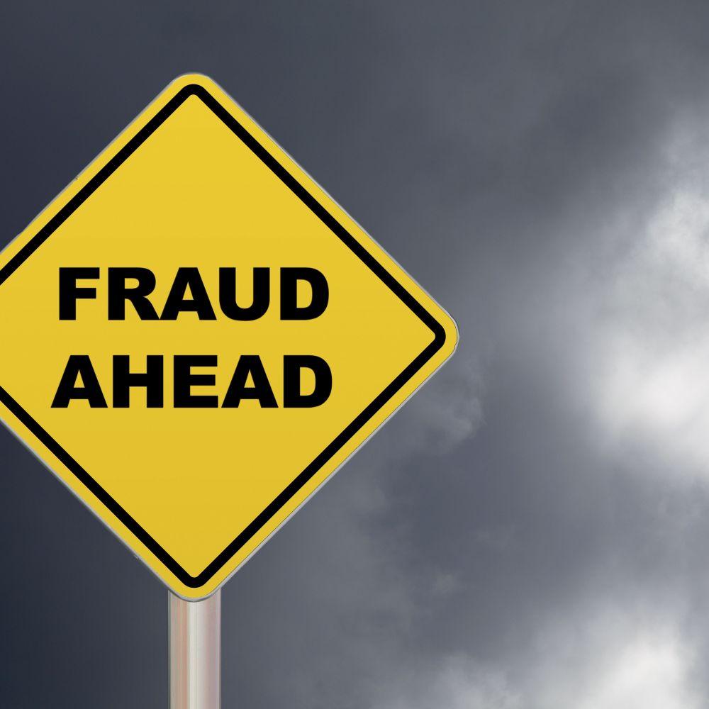 crossing-sign---fraud-ahead-697219150-4a560f15506942cb864a0c66432e4191